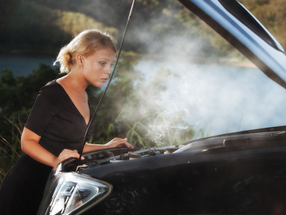 Lady with car hood up - steam rising